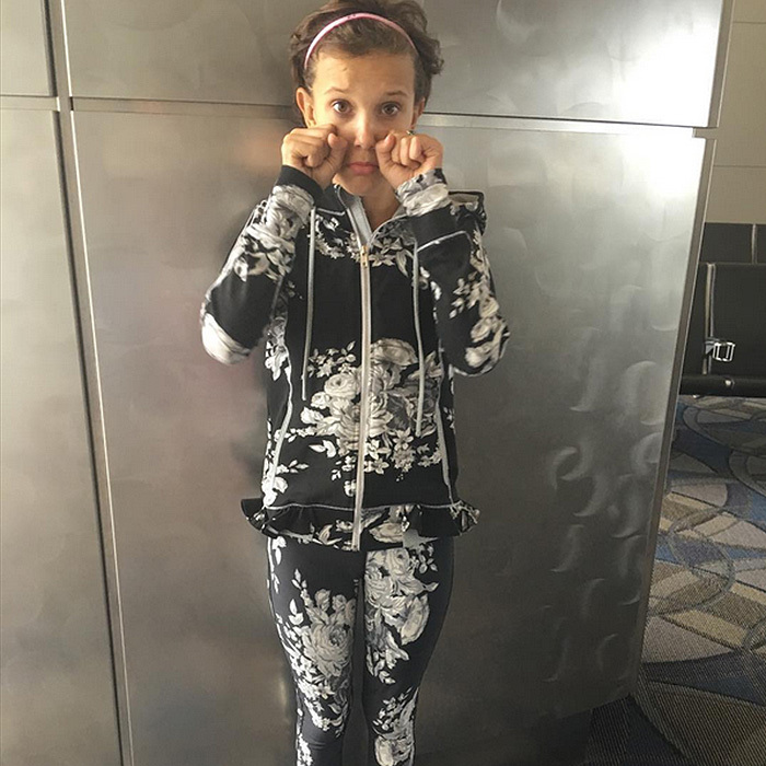 """Goodbye LA for now see ya real soon,loved my time here as always!"" Millie captioned this photo. She may have been sad to leave, but we still loved her choice of travel outfit – a matching floral jacket and leggings by Albion Fit.