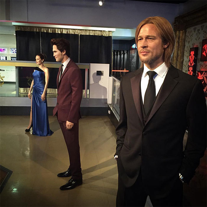"While the divorce papers might not be signed, the couple's split is official at Madame Tussauds. A day after the couple's split broke, the famous wax museum in London announced that they had separated Brad and Angie's wax figures. ""Following the news that has shocked celebrity watchers worldwide, we can confirm we have separated Brad Pitt and Angelina Jolie's figures,"" Madame Tussauds tweeted along with a photo of the figures separated by Robert Pattinson.