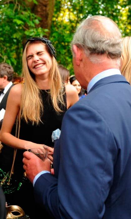 At the same event, Cara had a good laugh with Prince Charles. 