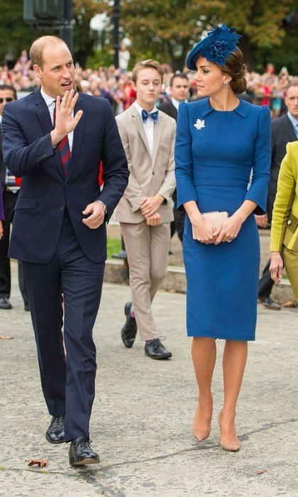 Touching down in Victoria, British Columbia for their September 2016 visit to Canada, Kate Middleton went with one of her favorite designers - Jenny Packham. She accessorized with the Queen's diamond maple brooch and a Lock Hatters hat.