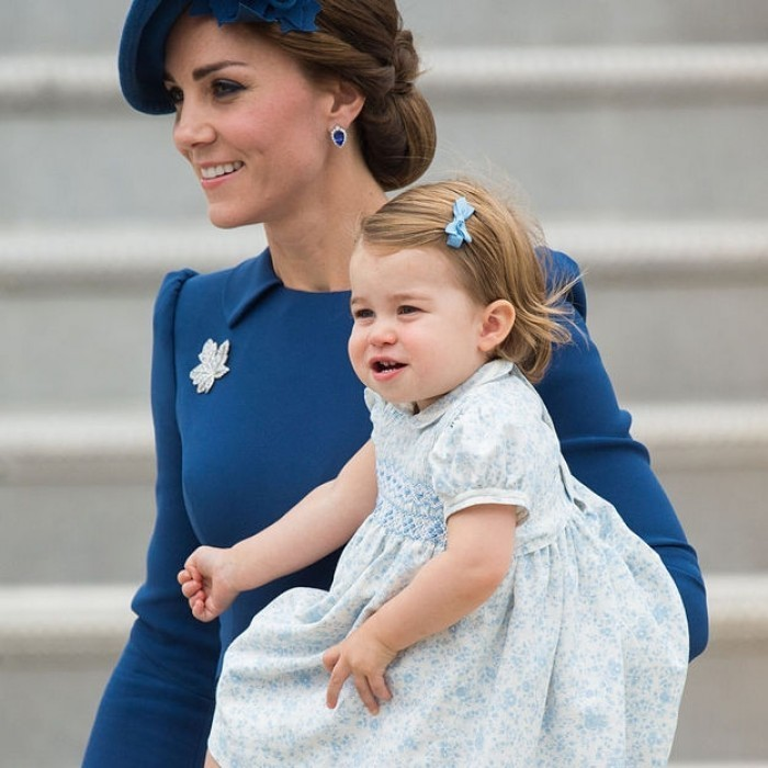 Kate held 16-month-old Princess Charlotte tight as they made their way down the plane in Victoria, Canada for their eight day royal tour.