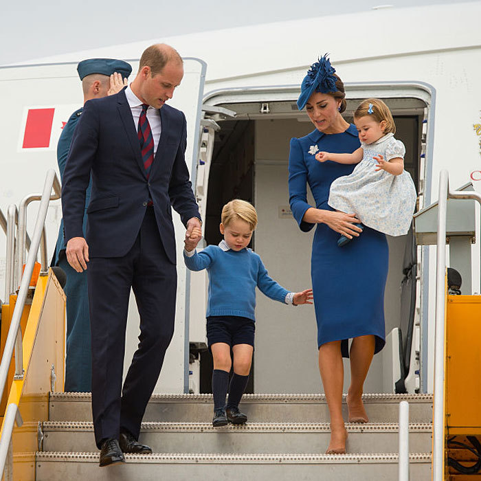 The Duke of Cambridge kept a close eye on his son as he cautiously made his way down the stairway.