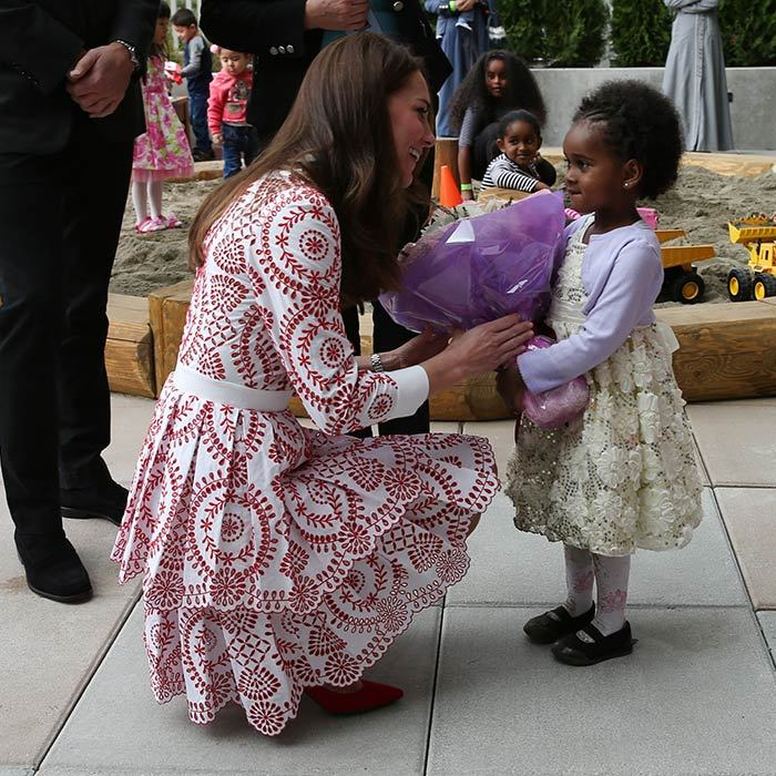 "The Duchess of Cambridge accepted flowers from four-year-old Peneil Zemenfekidus. Kate replied, ""Oh wow, thank you so much,"" during her visit to the Immigrant Services Society of British Columbia New Welcome Centre in Vancouver. 