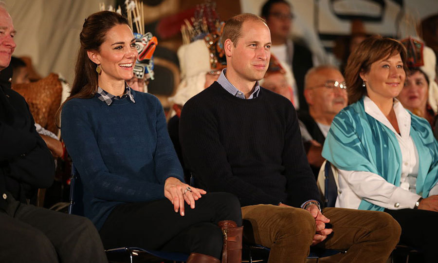 Kate and William, who coordinated in pullover sweaters and collared shirts, were all smiles at they watched the performance. 