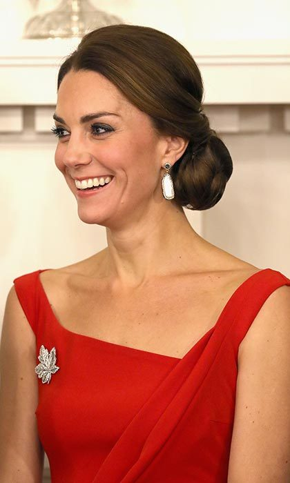 Prince William's wife wore drop earrings and Queen Elizabeth's maple leaf brooch, her hair upswept in a perfect chignon.