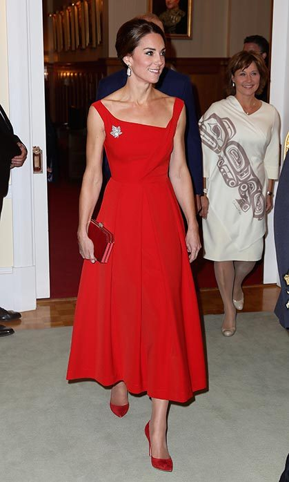 Duchess Kate wowed in a red Preen creation with an asymmetrical neckline. The beautiful tea-length frock is the British brand's Finella Midi Dress, and has a price tag of $1715.