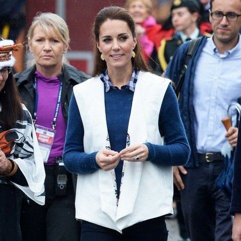 The Duchess, who swapped her jacket for an embroidered vest during the visit, wore her hair smoothed back for the casual day out. 