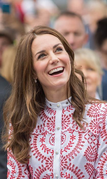The Duchess of Cambridge opted for a tousled beach wave look as she visited the Immigrant Services Society's new Welcome House on September 25, 2016 in Vancouver, Canada.