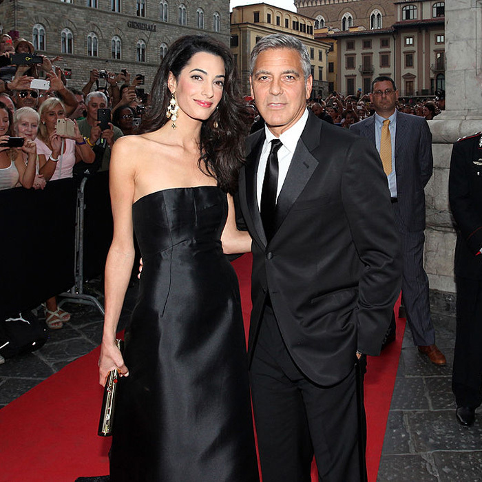 The Clooneys looked sharp in coordinating black ensembles for the 2014 Celebrity Fight Night in Italy Benefitting The Andrea Bocelli Foundation and The Muhammad Ali Parkinson Center Gala.