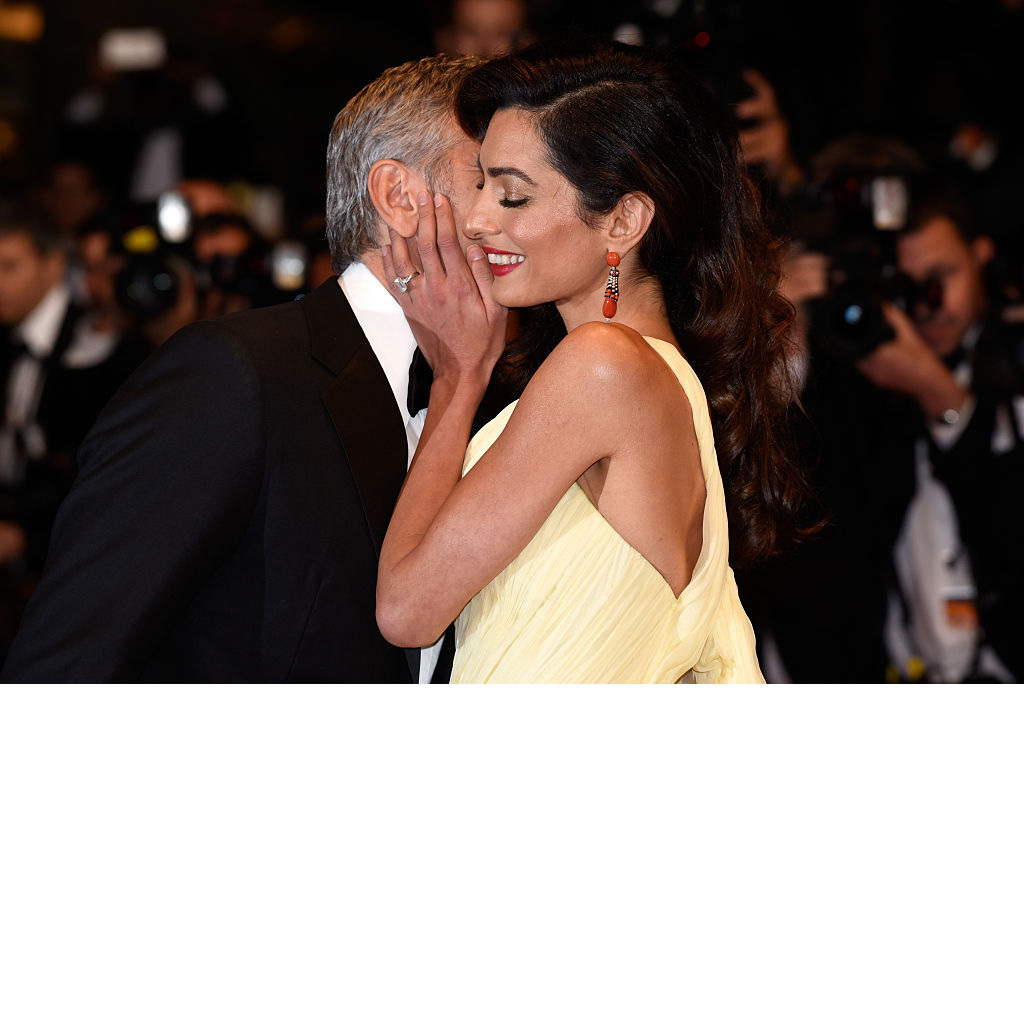 George Clooney planted a kiss on his beautiful wife at the <i>Money Monster</i> premiere in Cannes, France. 