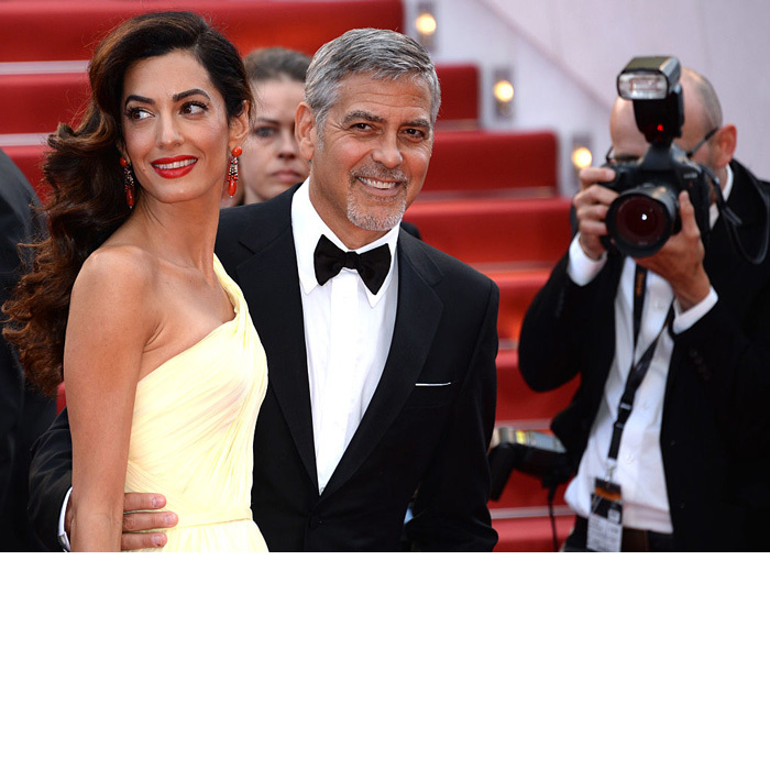 He's with her! George beamed as he kept his wife Amal close during the 69th annual Cannes Film Festival.