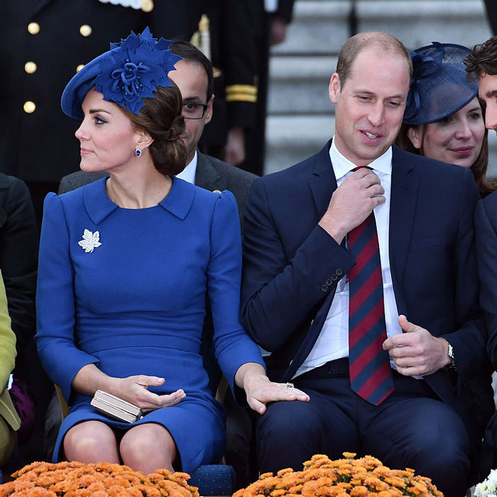 Kate Middleton placed her hand on her husband's thigh at an official welcoming ceremony for them on day one of their 2016 royal tour of Canada.