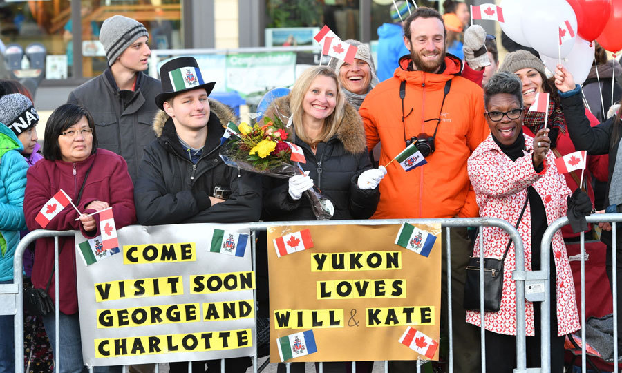 Well-wishers waved flags and held balloons and signs for the couple.