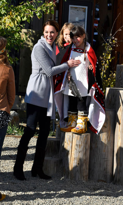 Kate shared a laugh with Okasana Baerg, who showed the Duchess her black feathers during her and William's visit to Carcross Commons.