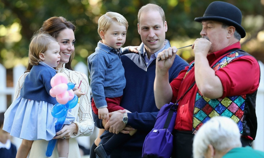 Charlotte waited in awe as she watched a man blow up a balloon with her parents and brother George, during her first royal engagement at a children's party for military families during the royal tour in Canada. 