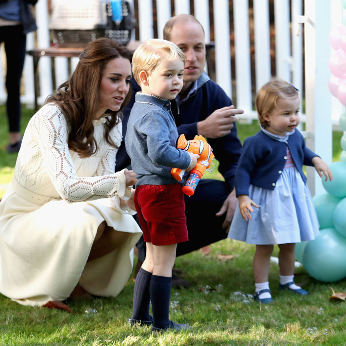 George got his hands on an orange bubble gun toy, which he use to squirt bubbles at his sister and father during a children's party in Victoria, Canada.