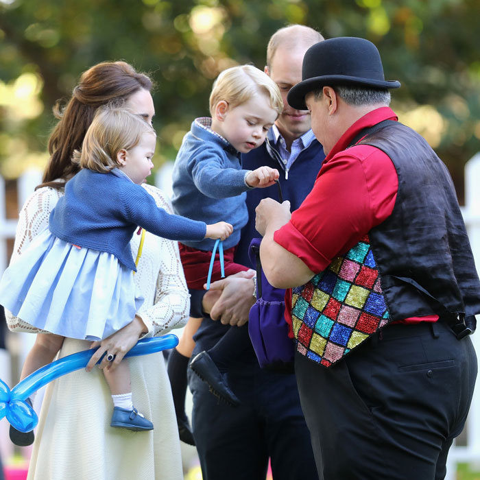 The royal youngsters were amused by balloons and even pulled uninflated ones from the party entertainer's pouch.
