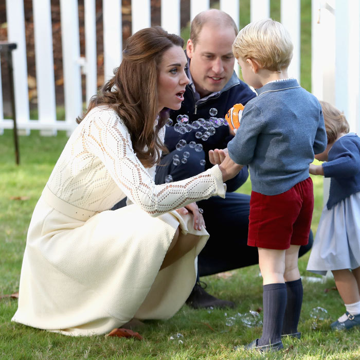 The Duchess looked surprised as her young son squirted bubbles at her and Prince William with his orange bubble gun in Canada.