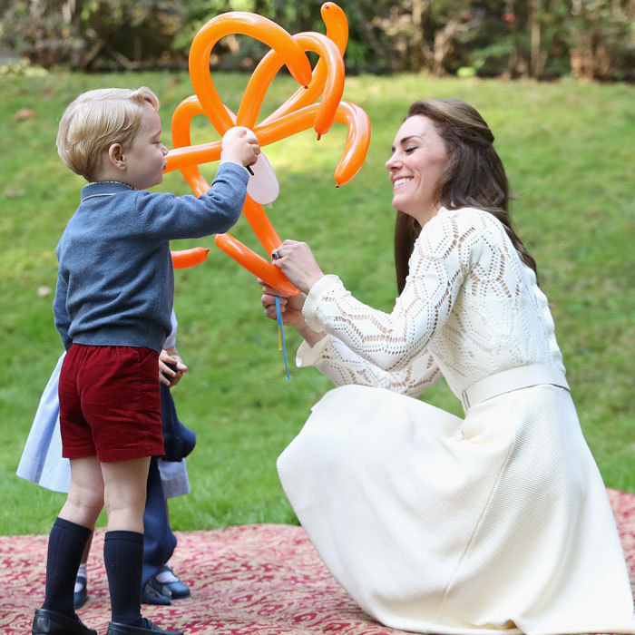 Prince William's wife laughed as George played with his mom and an animal balloon.