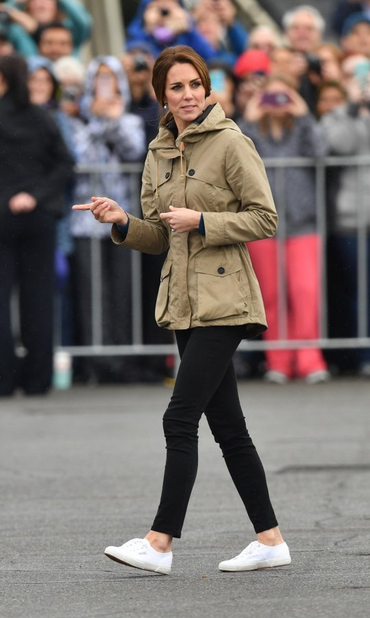 The Duchess wore a Troy London parka over her skinny jeans along with white tennis shoes for the outing. 