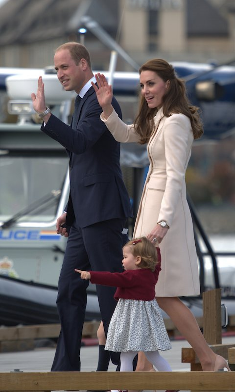 Princess Charlotte seemed to be just as excited about the boats and planes at the dock.