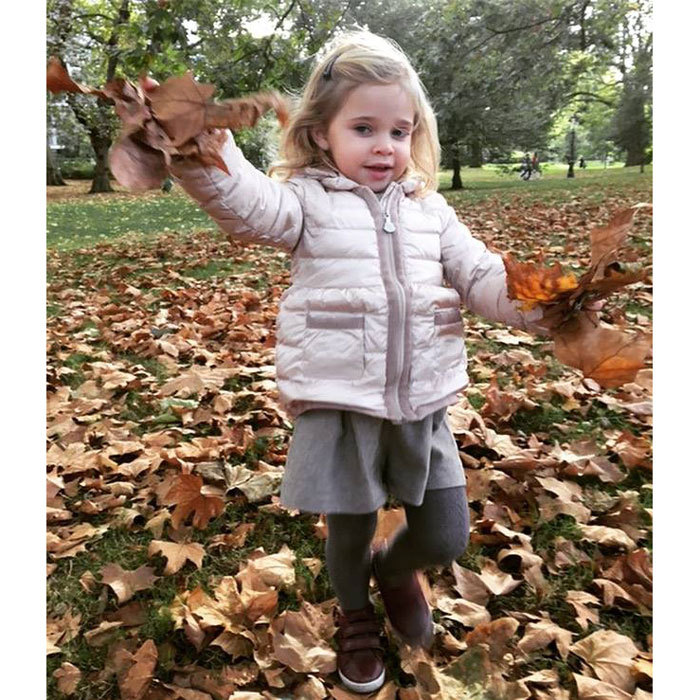 "The adorable Princess is ready to fall into fall! The royal tot's mom posted a photo of her little girl dressed in her autumn best playing in a pile of leaves. Attached to the photo, Princess Madeleine wrote, ""The fall is here!""