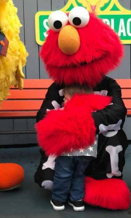 Carrie Underwood and Mike Fisher's son Isaiah shared a sweet moment with his new BFF Elmo during a visit to Sesame Place. 