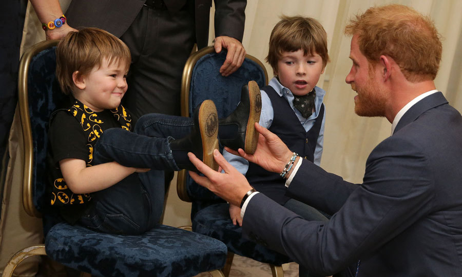 Feet first! Noah and Oscar Evans greeted Prince Harry at the 2016 WellChild Awards in London, where the royal was on hand to recognize the courage of ill children and those who care for them.