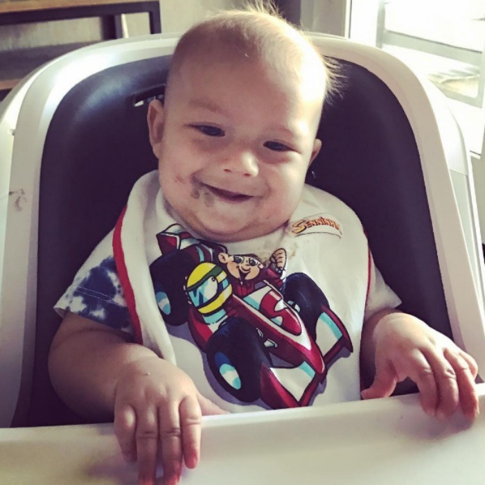 "Big boy! Boomer Phelps showed off his post-dinner smile after he reached another milestone with a photo that read, ""I think I'm starting to like eating this real food.""