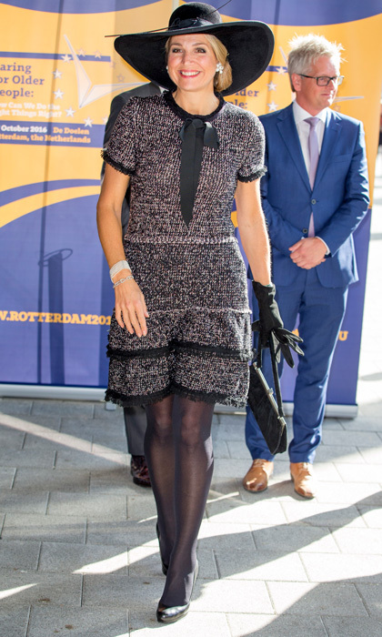 "The monarch accessorized her chic tweed dress with a matching black floppy to attend the ""Caring for Older People: How Can We Do The Right Things Right?"" meeting in Rotterdam.