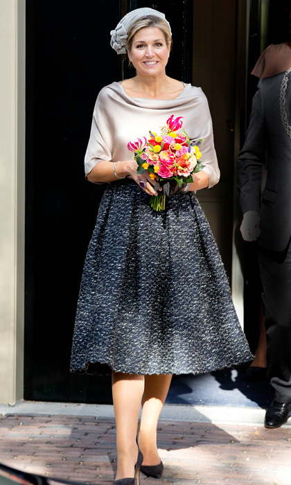 The Dutch royal channeled her inner Jackie O with a grey pillbox-like fascinator for her outing to Apeldoorn, Holland to open the Anna Pavlovna exhibition at the Het Loo Palace Museum.