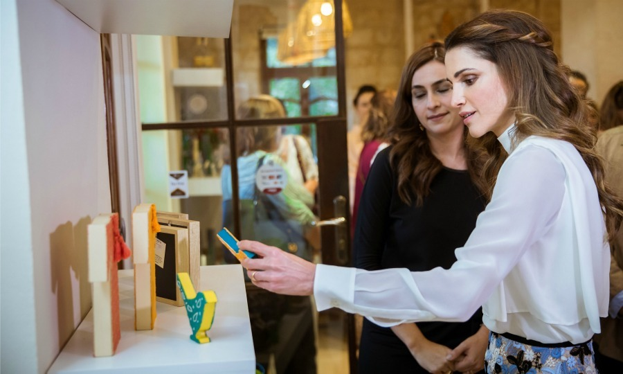 "<a href=""http://us.hellomagazine.com/tags/1/queen-rania/""><strong>Queen Rania</strong></a> checked out one of the pieces during the Jordan River Foundation's (JRF) 21st annual handicrafts <i>Dahnoon</i> exhibition at the organization's main showroom in Amman, Jordan.