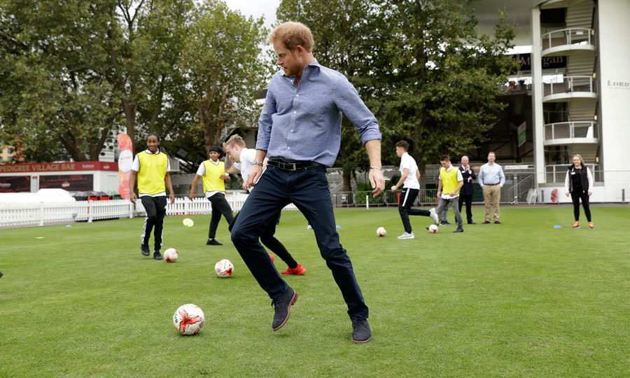 "Harry was put through his paces, kicking a soccer ball in addition to throwing/catching a tennis ball and netball. ""That's quite hard work,"" Harry said after he was told he was only halfway through the exercise. ""I'm dizzy already.""