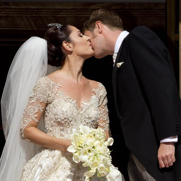 The bride gave her new husband the Crown Prince a sweet kiss after the ceremony.