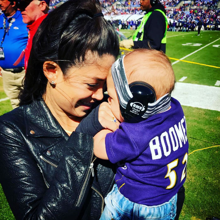 "Boomer made it on to the Ravens' football field, cuddling up close to mom Nicole Johnson. Michael Phelps' fiancée shared a photo with her baby boy, which she captioned, ""Waiting on the sidelines for daddy @m_phelps00 #hesmyeverything.""