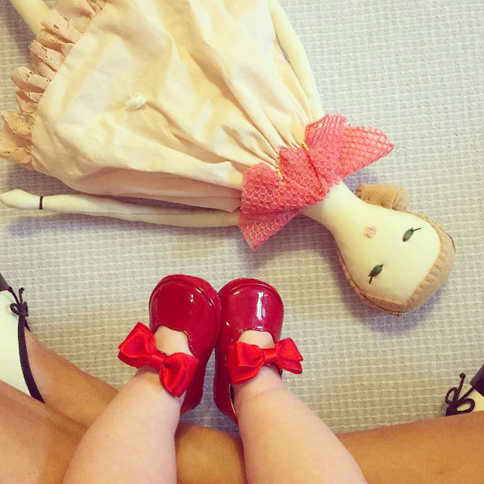 "A rainy day means playtime! Nicky Hilton gave fans a glimpse at her daughter Lily-Grace Rothschild. Sharing a photo of her little girl's stylishly-clad feet, she wrote, ""On rainy days we play with dolls + shoes.""