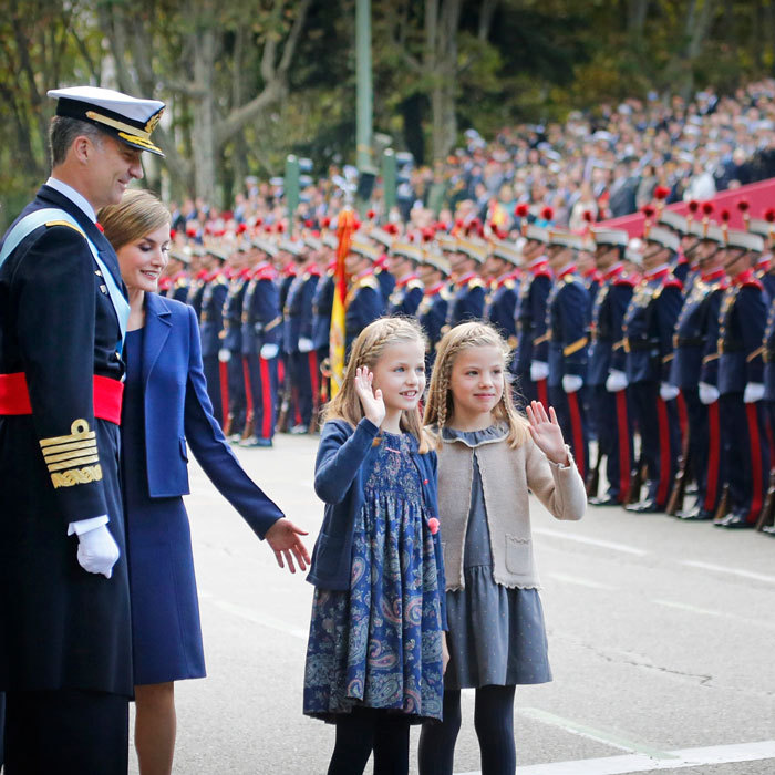 Letizia and Felipe proudly looked on at their daughters as they waved to fans attending Spain's 2015 National Day celebrations. 