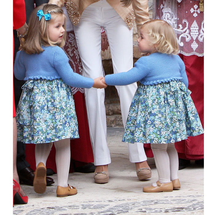 Princess Leonor sweetly held on to her little sister Sofia's hand as they left Easter mass in 2009.