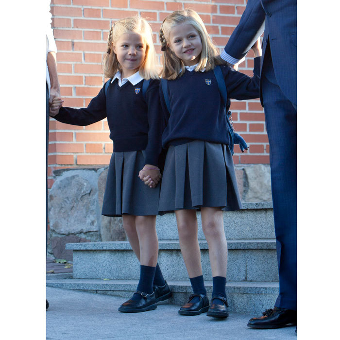 Off to school! Sofia held tightly on to her big sister Leonor's (right) hand as they arrived to their Santa Maria de los Rosales school in 2012. 