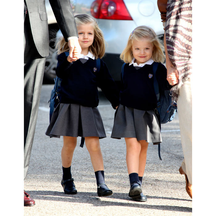 The royal siblings clasped hands as they arrived for their first day of the school year at Santa Maria de los Rosales in 2010. 