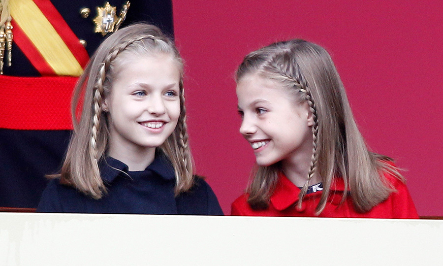 The adorable duo grinned from ear-to-ear as they took in celebrations on Spain's National Day.