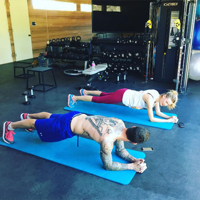"<a href=""http://us.hellomagazine.com/tags/1/behati-prinsloo/""><strong>Behati Prinsloo</strong></a> shared a peek from a gym session with husband <a href=""http://us.hellomagazine.com/tags/1/adam-levine/""><strong>Adam Levine</strong></a>. ""Kinda have a thing for my trainer,"" she joked in the caption. 
