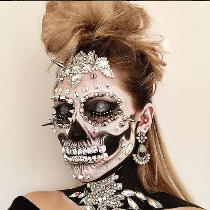 Not for the Halloween party wallflower, this fierce face is created with Swarovski crystals and spikes. 