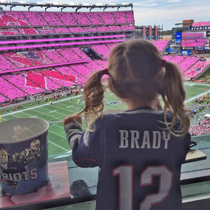 "Tom Brady's daughter Vivian cheered on her football playing dad alongside her mom Gisele Bundchen. Attached to the photo of her little girl, the model wrote, ""Go papai go! #gopats.""