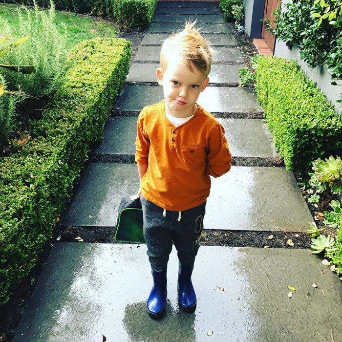 "Luca Comrie is growing up fast. Hilary Duff posted a photo of her son looking sharp in his rain boots with a lunchbox on hand. The TV Land star captioned the picture, ""Basically an adult [with a sad face emoji].""