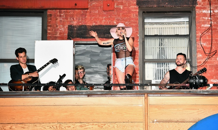 "October 20: Sing it from the rooftop! <a href=""http://us.hellomagazine.com/tags/1/lady-gaga/""><strong>Lady Gaga</strong></a> went back to her roots for a performance at The Bitter End for her Bud Light x Lady Gaga Dive Bar Tour stop in NYC. Along for the ride were writing partners Mark Ronson and Hilary Lindsey who took the stage with the pop star.