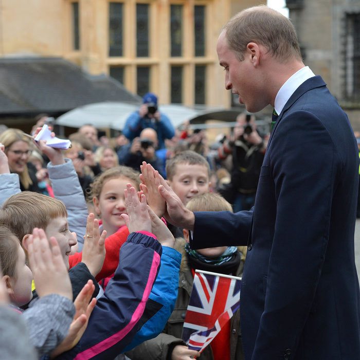 The Duke of Cambridge gave high-fives to local children during a visit to the Argyll and Sutherland Highlanders Regimental Museum at Scotland's Stirling Castle.