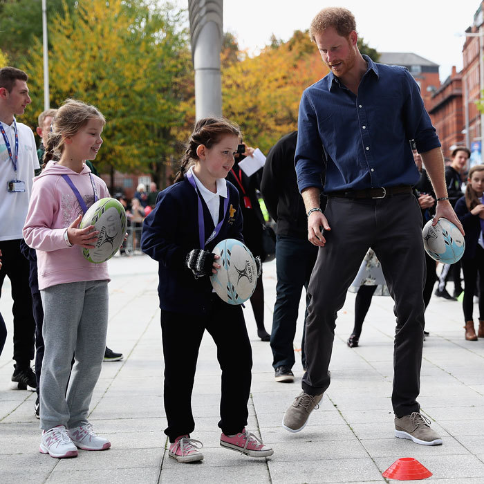 The royal certainly looked the part of a coach. Harry got rugby skills training, while visiting the National Ice Centre in Nottingham to see the work of the Coach Core program.