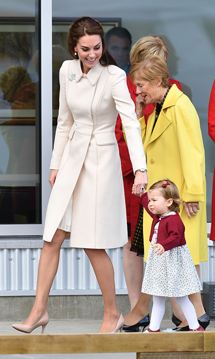 Duchess Kate wore a bespoke Catherine Walker coat as she held hands with daughter Princess Charlotte during the Cambridges' trip to Canada in 2016.