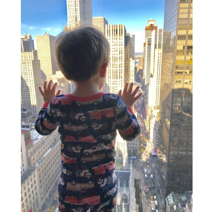 "Isaiah Fisher is in a <i>New York state of mind</i>. Carrie Underwood posted a photo of her young son peering out a Manhattan window writing, ""The boy taking in NYC.""